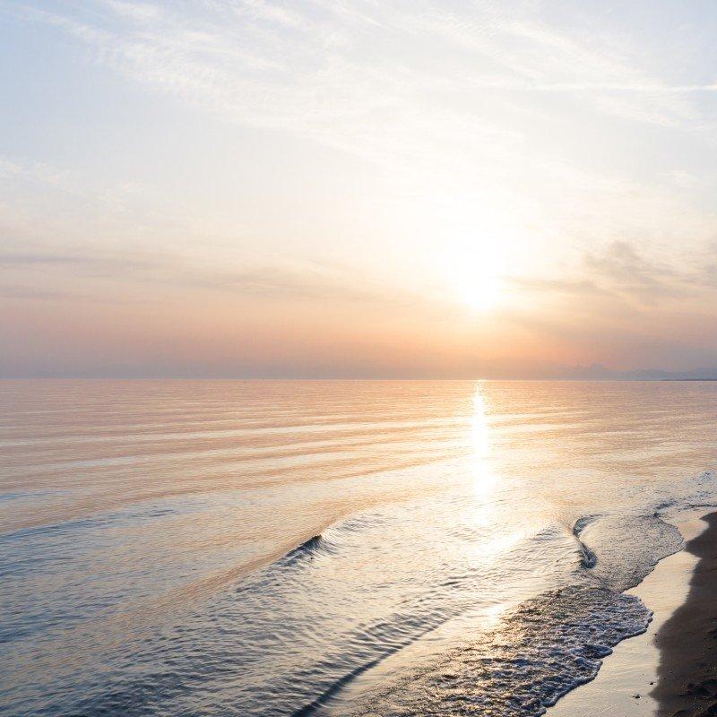 Sandy Beach: The Greek Island Of White Cliffs And Sandy Beaches
